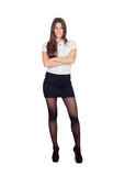 Pretty businesswoman in a stylish miniskirt. Isolated on white Royalty Free Stock Photos