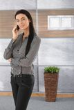 Pretty businesswoman talking on mobile smiling Royalty Free Stock Photo