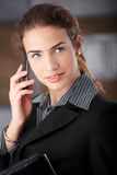 Pretty businesswoman talking on mobile smiling Stock Image