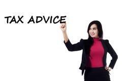 Pretty businesswoman with tax advice Stock Photo