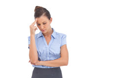 Pretty businesswoman thinking with closed eyes. On a white background stock image