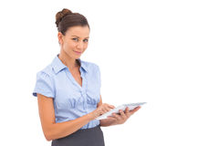 Pretty businesswoman touching digital tablet Royalty Free Stock Photo