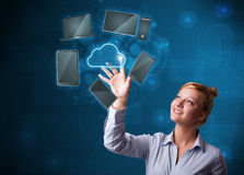 Pretty businesswoman touchning high technology cloud service Royalty Free Stock Photography