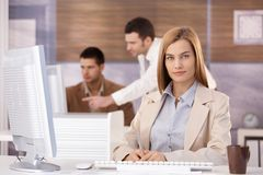 Pretty businesswoman at training course smiling Royalty Free Stock Photos