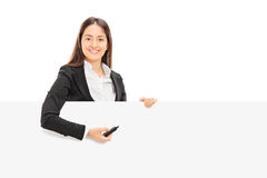 Pretty businesswoman trying to write notes on a panel Stock Images