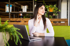 Pretty businesswoman using computer in office Stock Image