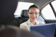 Pretty businesswoman using her tablet pc Stock Photography