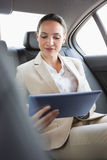 Pretty businesswoman using her tablet pc Royalty Free Stock Image
