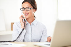 Pretty businesswoman using the phone in the office Royalty Free Stock Photo