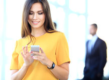 Pretty businesswoman using smart phone stock image