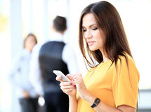 Pretty businesswoman using smart phone Royalty Free Stock Photo