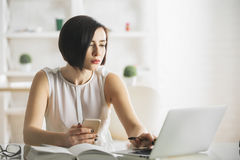 Pretty businesswoman using technology Royalty Free Stock Photography
