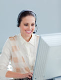 Pretty businesswoman working at a computer Royalty Free Stock Photography