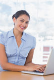 Pretty businesswoman working on her laptop Royalty Free Stock Photography