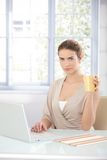 Pretty businesswoman working on laptop Stock Image