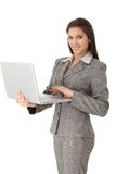 Pretty businesswoman working on laptop Stock Photo