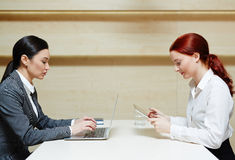 Pretty businesswomen working on computers Stock Photo
