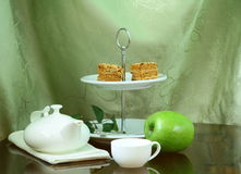 Pretty cake stand with elegant  tea set Royalty Free Stock Image