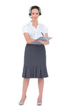 Pretty call center agent holding clipboard Royalty Free Stock Photography