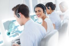 Pretty call center worker using futuristic interface hologram Royalty Free Stock Photo