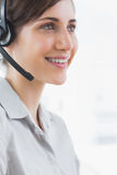 Pretty call centre agent smiling close up Royalty Free Stock Photography