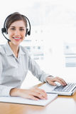 Pretty call centre agent working at desk Royalty Free Stock Photography