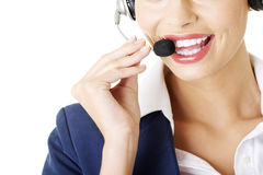 Pretty call-centre assistant smiling at the camera Royalty Free Stock Images