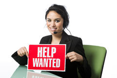 Pretty call service rep with a Help Wanted Sign Royalty Free Stock Photography