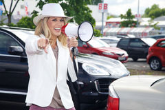 Pretty car saleswoman megafone Stock Photos