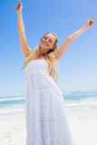 Pretty carefree blonde smiling at camera on the beach Royalty Free Stock Photos