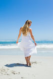 Pretty carefree blonde walking on the beach Stock Image