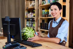Pretty Cashier at Wooden Counter Stock Photography
