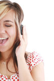 Pretty casual brunette is listening to music Stock Image