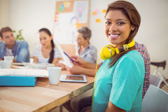 Pretty casual businesswoman with yellow headphones Royalty Free Stock Image