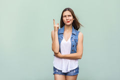 Pretty casual style girl with freckles got the idea and she raised her finger up and thinking. Stock Photos