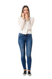 Pretty casual woman in jeans and braided shirt talking on the cellphone. Stock Images