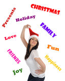 Pretty casual woman in red christmas hat stock photography