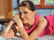 Pretty casual woman relaxing indoors Royalty Free Stock Images