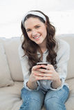 Pretty casual woman text messaging on her smartphone Royalty Free Stock Photography