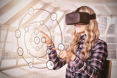 Pretty casual worker using oculus rift. Against modern office Royalty Free Stock Image