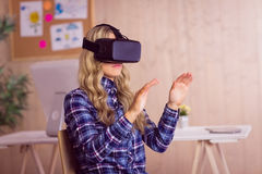 Pretty casual worker using oculus rift Royalty Free Stock Image