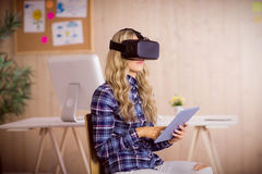 Pretty casual worker using oculus rift Stock Image