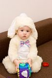 Pretty caucasian baby in rabbit costume playing Royalty Free Stock Photography