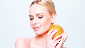 Pretty Caucasian Blond Girl Holding Orange Fruit stock footage