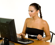 Pretty Caucasian business woman at office desk Stock Photos