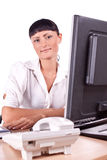 Pretty Caucasian business woman at office desk Stock Image