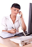 Pretty Caucasian business woman at office desk Royalty Free Stock Photography