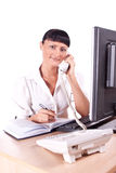 Pretty Caucasian business woman at office desk Royalty Free Stock Image