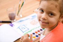 Pretty caucasian child paint watercolor Royalty Free Stock Photography