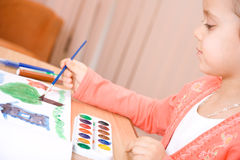 Pretty caucasian child watercolor paint Royalty Free Stock Image
